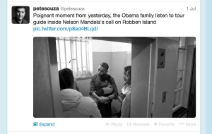 This July 1, 2013, screen grab from the Twitter Page of the official White House photographer, Pete Souza, shows a tweet featuring an image of President Barack Obama and his family listening to a tour guide inside Nelson Mandela's cell on Robben Island on June 30, 2013, in Cape Town, South Africa. The White House barred press photographers from this portion of the tour saying it was private, but then released their own photos of from Mandela's cell. (AP Photo/The White House)