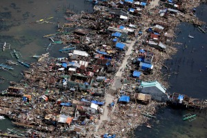 An aerial image taken from a Philippine Air Force helicopter shows the devastation of the first landfall by typhoon Haiyan in Guiuan, Eastern Samar province, central Philippines Monday, Nov. 11, 2013. (AP Photo/Bullit Marquez)