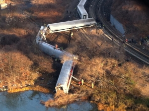 Cars from a Metro-North passenger train are scattered after the train derailed in the Bronx neighborhood of New York, Sunday, Dec. 1, 2013. (AP Photo/Edwin Valero)