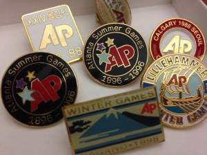 AP souvenir Olympic pins from years past.