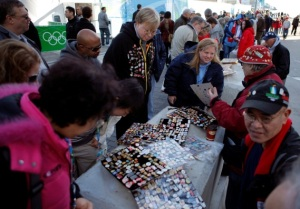 People trade Olympic pins at a pin trading site in Vancouver, British Columbia, Wednesday, Feb. 17, 2010. (AP Photo/Jae C. Hong)