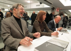 "Panelists sign copies of the AP book ""Vietnam: The Real War"" after a forum at New York's 92nd Street Y on photography and media coverage of the war, Thursday, Feb. 27, 2014. From left are Pete Hamill, author of the book's foreword; AP national security journalist Kimberly Dozier and former AP Saigon journalist Peter Arnett, who received a Pulitzer Prize for his Vietnam coverage. (AP Photo)"