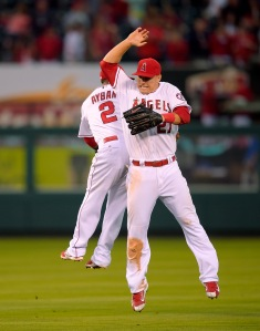 Los Angeles Angels' Erick Aybar, left, celebrates with Mike Trout after they defeated the Texas Rangers 5-2 in a baseball game, Sunday, June 22, 2014, in Anaheim, Calif. (AP Photo/Mark J. Terrill)