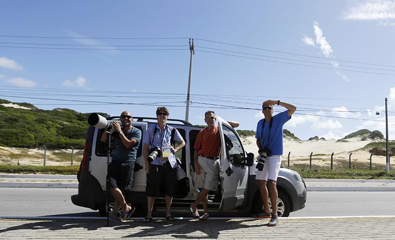 From left, AP staff Hassan Ammar (Cairo), Petr David Josek (Prague), Bruce Hanselman (Atlanta) and Ricardo Mazalan (Bogota) pose for a photo outside of a Hotel where the team of Uraguay and Luis Suarez stays in Natal, Brazil, Wednesday, June 25, 2014. (AP Photo/Petr David Josek)