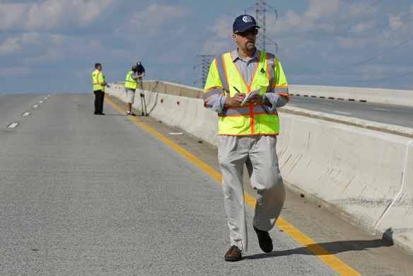AP correspondent Randall Chase walks on the damaged bridge in Wilmington, Del. (AP Photo/Patrick Semansky)