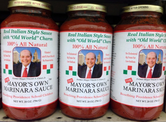 "In this Aug. 8, 2014 photo, bottles of former Providence Mayor Buddy Cianci's pasta sauce sits on the shelf at a grocery store in Providence, R.I. Below his photograph is printed the line ""Benefiting Providence School Children."" In recent years, no money from sales of the sauce has been donated to Cianci's charity scholarship fund. (AP Photo/Michelle R. Smith)"