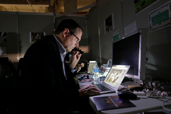 Washington Assistant Chief of Bureau David Ake edits during the Super Bowl blackout, Sunday, Feb. 3, 2013, at the Superdome in New Orleans. (AP Photo/Julie Jacobson)