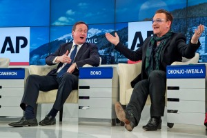 "British Prime Minister David Cameron and  rock star Bono speak during the panel discussion  ""The Post-2015 Goals: Inspiring a New Generation to Act"", the fifth annual Associated Press debate, at the World Economic Forum in Davos, Switzerland, Friday, Jan. 24, 2014.  (AP Photo/Michel Euler)"
