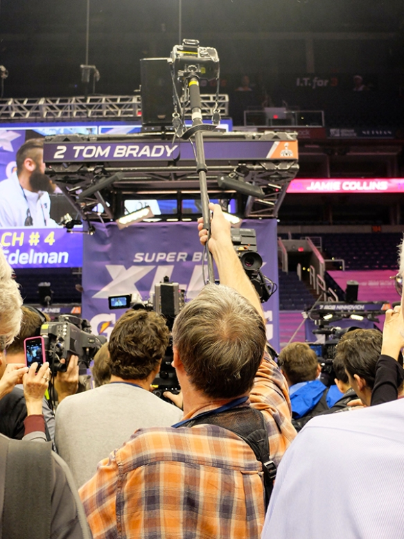 Photographer Charlie Riedel shown during  Super Bowl XLIX Media Day at the U.S. Airways Arena in Phoenix, Ariz., Tuesday, Jan. 27, 2015. (AP Photo/Carolyn Kazdan)