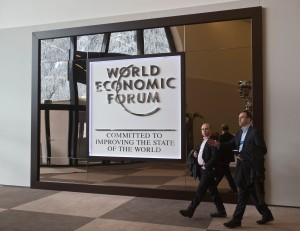 Participants walk in the main entrance hall of the Congress Center the day before the opening of the annual meeting of the World Economic Forum in Davos, Switzerland, Tuesday, Jan. 20, 2015. The world's financial and political elite will head this week to the Swiss Alps for 2015's gathering of the World Economic Forum at the Swiss ski resort of Davos. (AP Photo/Michel Euler)
