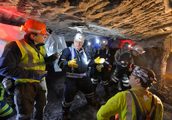 AP reporter Dylan Lovan, left, interviews U.S. Assistant Secretary of Labor Joseph Main, center, in southern Indiana's Gibson North coal mine. (AP Photo/Timothy D. Easley)