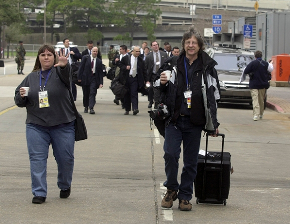 Photo News Editor Stephanie Mullen, left, and photographer Ric Feld walk to the Superdome in New Orleans for NFL Super Bowl XXXVI, Feb. 3, 2002. (AP Photo/Mark Duncan)