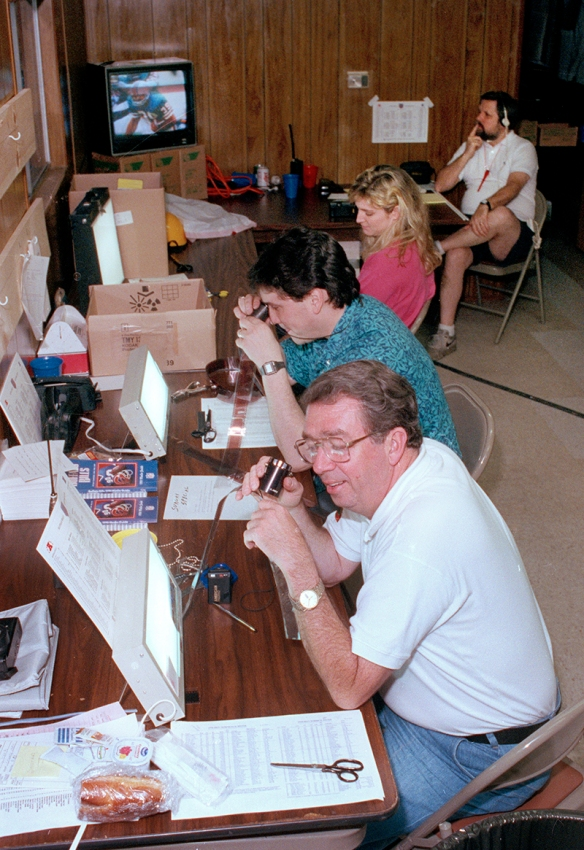 From front, photographers Spencer Jones, Rob Kozloff, Claudia Counts and Brian Horton work from a trailer for the NFL Super Bowl XXV football game in Tampa, January 1991. (AP Corporate Archives photo)