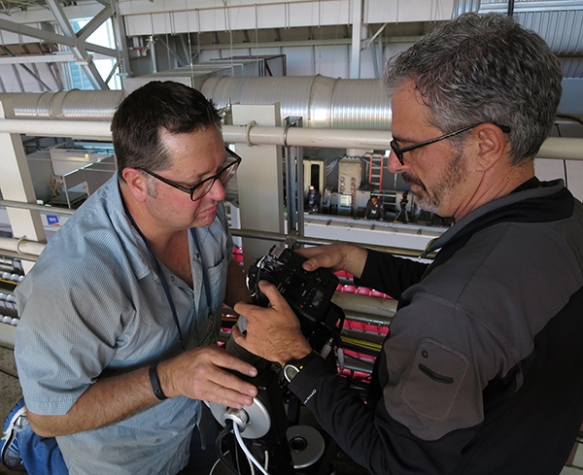 Photographers David Phillip, left, and Morry Gash work on a robotic camera in preparation for for Super Bowl XLIX, Saturday, Jan. 24, 2015. (Photo by Denis Paquin)