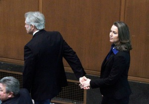 In this Jan. 12, 2015 file photo, Oregon Gov. John Kitzhaber escorts his fiancee, Cylvia Hayes, onto the House floor before he is sworn in for an unprecedented fourth term as Governor in Salem, Ore. Kitzhaber announced his resignation Friday, Feb. 13, 2015, amid allegations Hayes used her relationship with him to enrich herself. (AP Photo/Don Ryan, file)