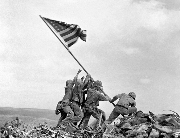 U.S. flag raised atop Mt. Suribachi, Iwo Jima, Feb. 23, 1945. (AP Photo/Joe Rosenthal)