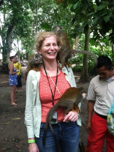 AP Travel Editor Beth Harpaz visits with monkeys on a trip to the Columbia Amazon. (Photo courtesy Beth Harpaz).