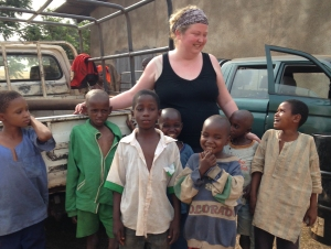 Krista Larson chats with orphans she interviewed at a Catholic church sheltering more than 800 Muslims in Carnot, Central African Republic who had fled sectarian violence. (AP Photo/Steve Niko)