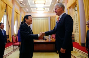 "President and CEO of the Associated Press Gary Pruitt, right, meets with Vietnam's President Truong Tan Sang, left, ahead of the opening of an exhibit of AP's wartime photographs, Thursday, June 11, 2015, in Hanoi, Vietnam. The exhibit ""Vietnam: The Real War,"" a collection of 58 photographs taken by the AP opens to the public Friday, June 12, 2015, in Hanoi. (AP Photo/Wong Maye-E)"