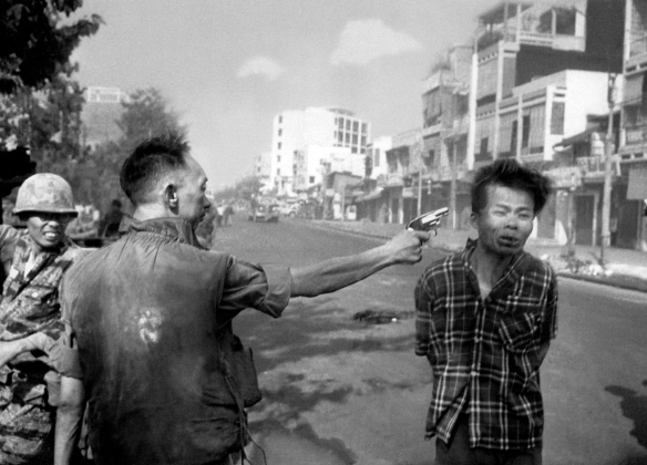 "FILE - In this Feb. 1, 1968, file photo, South Vietnamese Gen. Nguyen Ngoc Loan, chief of the National Police, fires his pistol into the head of suspected Viet Cong officer Nguyen Van Lem (also known as Bay Lop) on a Saigon street, early in the Tet Offensive. ""Vietnam: The Real War,"" a collection of 58 photographs taken by the AP opens to the public Friday, June 12, 2015, in Hanoi, (AP Photo/Eddie Adams, File)"