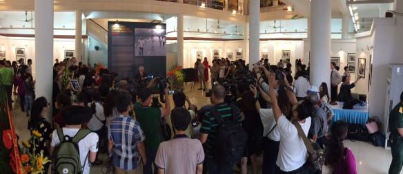 AP photographer Nick Ut addresses visitors at the opening of exhibit in Hanoi of AP's Vietnam War images on Friday, June 12. (AP photo/Ted Anthony)